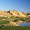 A view of a green with water on the right at The Course at Wente Vineyards
