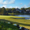 View of a bunkered green and lake at Las Colinas Country Club