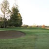 A view of a green guarded by a bunker at Grape Ranch Golf Club.