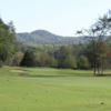 A view of a hole with mountains in the distance at The Rock Golf Club & Resort.