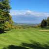 A sunny day view of a hole at Wharton Park Golf Club.