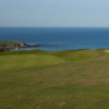 A view of a green with water in the distance at Bigbury Golf Club.