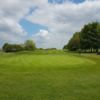 A sunny day view of a green at Broadway Golf Club.