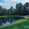A view of a green with water coming into play at Walden on Lake Conroe Golf & Country Club.
