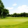 A sunny day view of a hole at Hollytree Country Club.