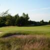 A sunny day view of a hole at Wigan Golf Club.