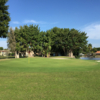 A sunny day view of a green at Costa Del Sol Golf Club.