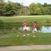 A view of the a tee near a pond at Twin Lakes Golf Course.