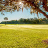 A sunny day view of a fairway at Riverside Golf Course.