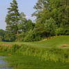 A sunny day view of a hole at Cobblestone Golf Course.