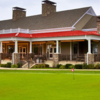 A view of the clubhouse and practice putting green at Quail Hollow Country Club.