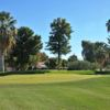 A sunny day view of a hole at Shalimar Golf Club.