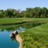 A view over the water of a hole at Los Lagos Golf Course.