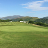 A sunny day view of a hole at Cockermouth Golf Club.