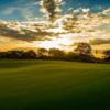 A sunset view of a green at Bonnie Doon Golf Club.