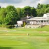A view of two greens and the clubhouse at Northwood Golf Club.