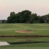 A view over the water of a hole at White Hawk Golf Club.