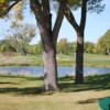 A view of a green with water coming into play at Coyote Run Golf Course.