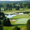 A view of a green protected by bunkers at Evergreen Resort.