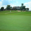A view of a hole and the clubhouse at the Country Club of Gwinnett.