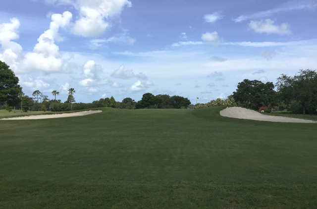 A view of a green flanked by bunkers at Clearwater Country Club.