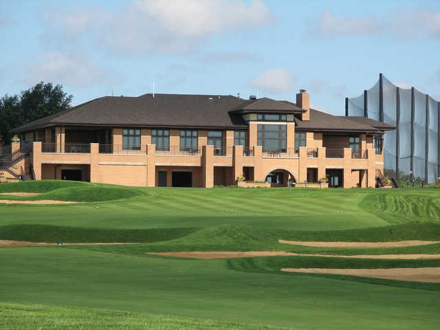 A view of the clubhouse and  a green at Highlands of Elgin.