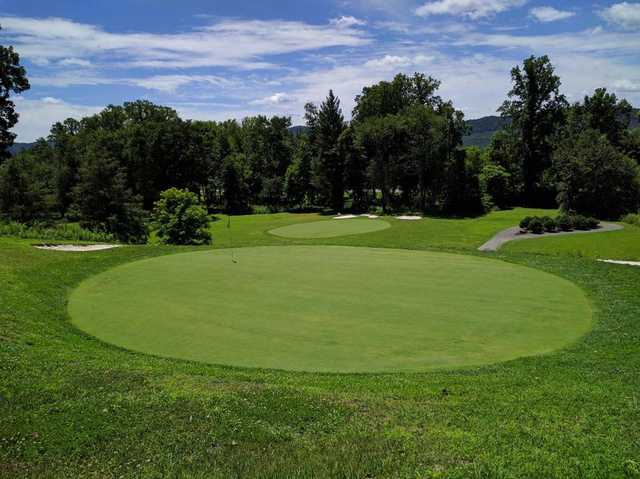 A sunny day view of two greens at  Middlesboro Country Club .