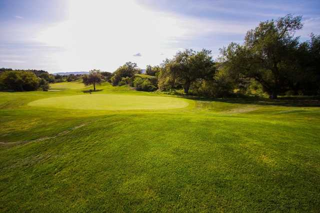 A sunny day view o a hole at CrossCreek Golf Club.