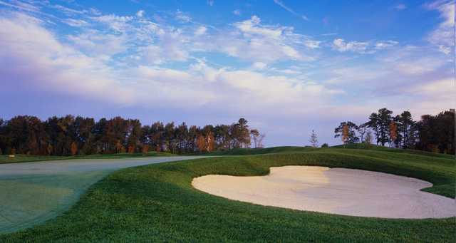 A fall day view of a hole at Heritage Shores Golf Club.