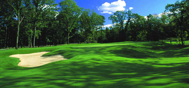 A sunny day view of a green at Fieldstone Golf Club of Auburn Hills.