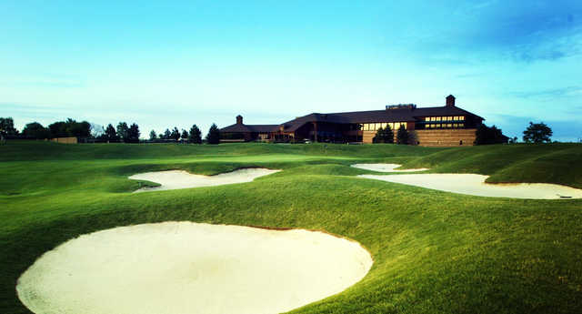 A view of a well protected hole and the clubhouse at Lakes of Taylor Golf Club.