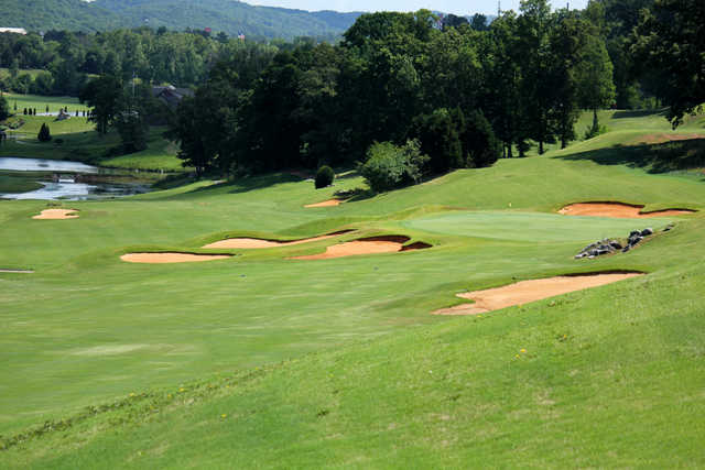 A view of a green surrounded by tricky bunkers at Avalon Country Club.