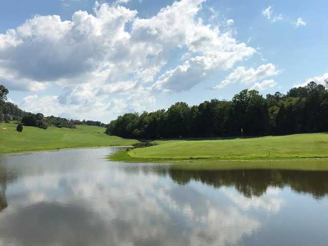 A sunny day view over the water of a hole at Avalon Country Club.