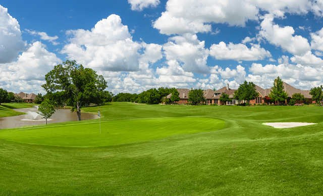 A view of a green and the clubhouse at Heritage Ranch Golf and Country Club.