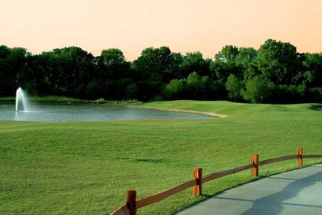 A view over a fence at Heritage Ranch Golf and Country Club.