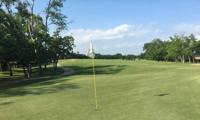 A sunny day view of a hole at Sienna Plantation Golf Club.