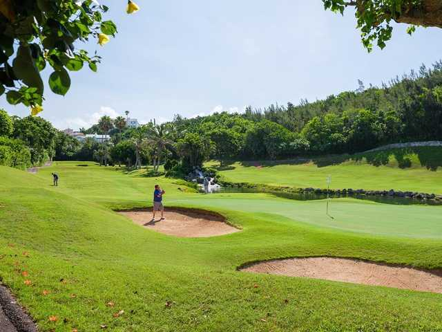 A sunny day view of a hole at Belmont Hills Golf Club.