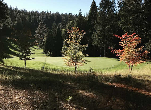 A fall day view of a green at Apple Mountain Golf Resort.