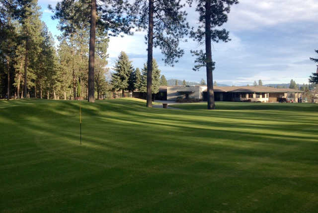 A view of a hole and the clubhouse at Coeur D'Alene Golf Club.