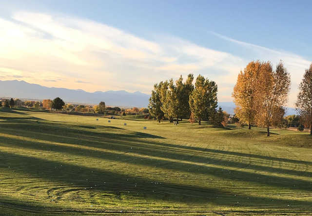 A fall day view of the driving range at Saddleback Golf Club.