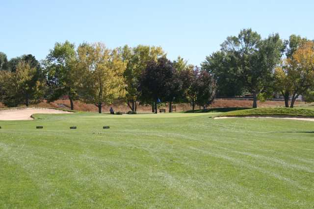 A view of a green flanked by bunkers at Cherokee Ridge Golf Course.