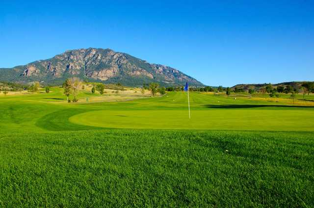 A sunny day view of a hole at Cheyenne Shadows Golf Club.