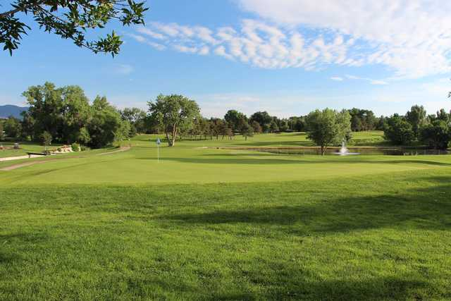 A sunny day view of a green at Patty Jewett Golf Course.