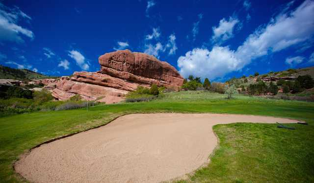 A view of the 16th green guarded by the Whale Rock at Red Rocks Country Club.