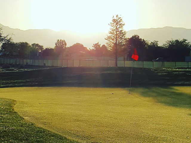A sunny day view of a hole at Ladera Golf Course.