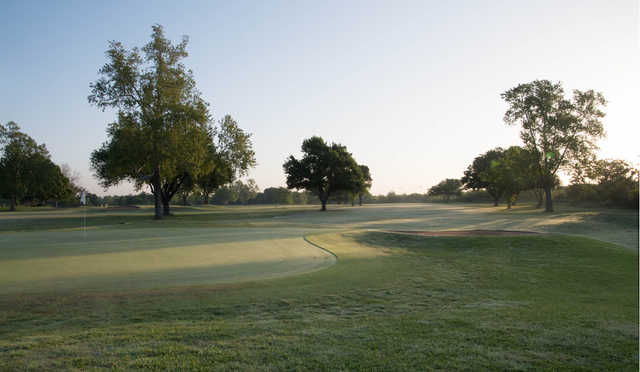 View of a green at Riverside Golf Course