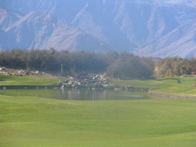 Mountains loom overhead and a waterfall rushes on No. 16.
