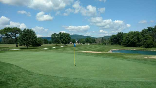 A view of a green with water and bunkers coming into play at Mountain View Golf Club.