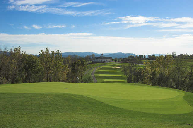 A view of hole #10 and the clubhouse in the distance at Blue Ridge Shadows Golf Club.