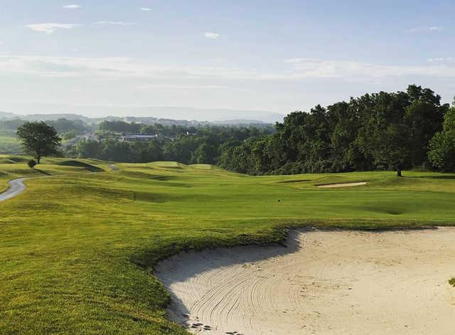 A sunny day view of a fairway at Blue Ridge Shadows Golf Club.